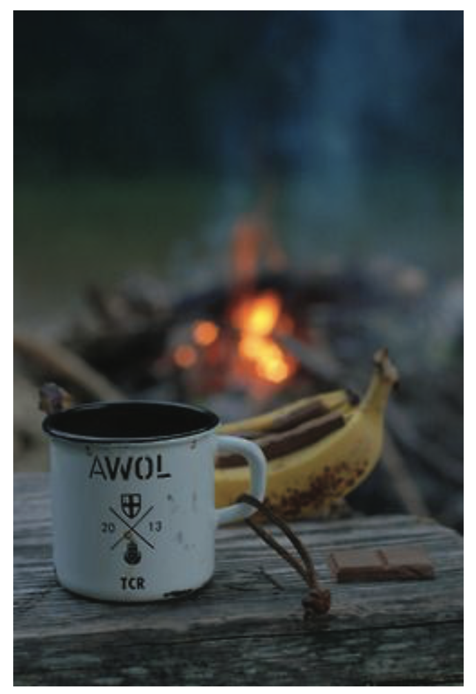Coffee Cup and Banana at Campfire